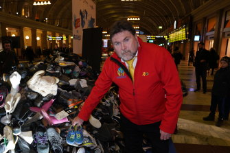 Peter Frazer adds a pair of shoes to a pile representingthe 3700 people who die on the streets every day. Peter's daughter Sarah died eight years ago in a road crash. He lobbied for more thanseven years for the introduction of Sarah's law.