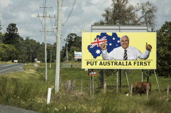 A Clive Palmer's United Australia Party billboard on the Bruce Highway near Mackay during the 2019 federal election.