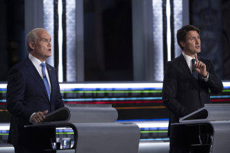 Conservative leader Erin O'Toole, left, and Liberal leader Justin Trudeau speak during the federal election French-language leaders debate.