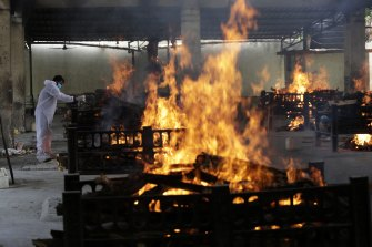 Flames rise from cremation pyres of 13 COVID-19 patients who died in a blaze that broke out in the Vijay Vallabh COVID-19 hospital, at Virar, near Mumbai, on Friday,
