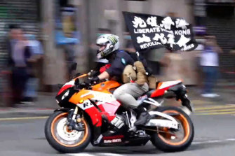 Tong Ying-kit riding his motorcycle during the protest in Hong Kong.