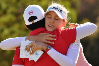 Nelly Korda from the USA and Haru Nomura of Japan after the end of play on day 3 of the Women's Australian Open.