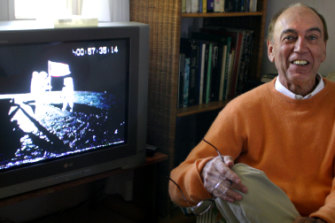 Peter Clifton at his home with a video of the moon landing, 2006.
