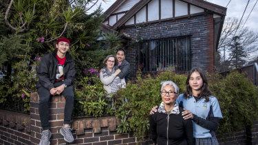 Auron Yi, Petra Yi, Peter Yi, Thi Xuan Dao Nguyen, Aliza Yi outside their Ashfield home.