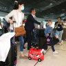 Travellers arriving at Brisbane Airport.
