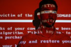 A message related to the NotPetya attack projected on a young man; governments and cyber experts across the globe struggled to respond to the attack in July 2017.