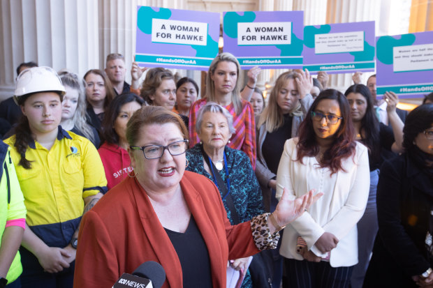 Corrections Minister Natalie Hutchins addresses a rally on the steps of Parliament House on Thursday.