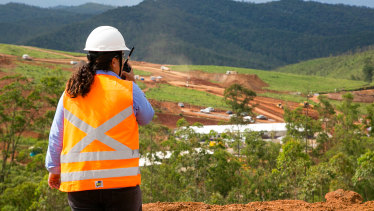A Renova worker overlooks the new Bento Rodrigues site from a recently built lookout.