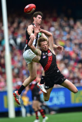 Magpies player Tyson Goldsack and the Bombers' Martin Gleeson contest.