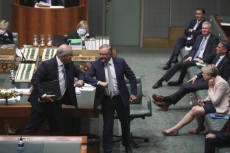 The Prime Minister and Opposition Leader Anthony Albanese elbow bump after delivering end-of-year statements to the House of Representatives in December.