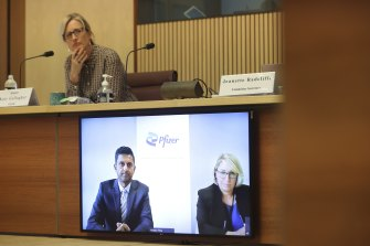 Pfizer Australia and NZ medical director of developed Asia Dr Krishan Thiru and market access director Louise Graham appear via videoconference as Senator Katy Gallagher listens, during a Senate hearing on COVID-19 on Thursday.