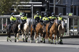 Police from the mounted branch outside the Queen Victoria market this morning.