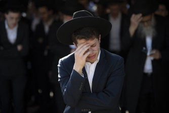 A mourner at the funeral of one of the stampede victims on Friday.