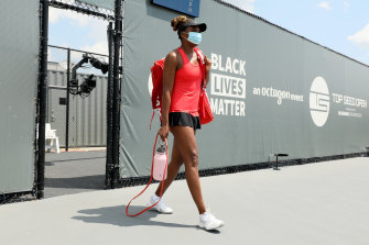 Venus Williams takes the court in Lexington wearing a face mask and in front of a Black Lives Matter banner.