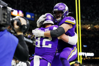 Kyle Rudolph (left) and Brian O'Neill celebrate after the former's match-winning touchdown in Louisiana.