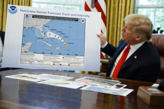 President Donald Trump holds the chart with the extended impact zone of Hurricane Dorian in the Oval Office in September.