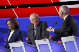 Senators Kamala Harris and Bernie Sanders listen to former vice-president Joe Biden.