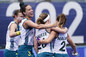 Rosie Malone (right) celebrates with Emily Chalker and Brooke Peris after scoring against China.