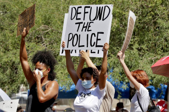 Protesters rally on June 3 in Phoenix, Arizona, demanding the city council defund the city's police department.