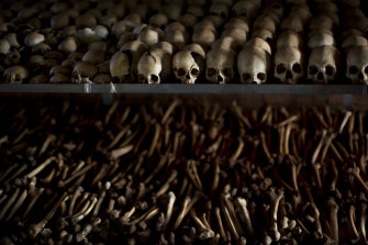 The skulls and bones of some of those slaughtered are laid out on shelves in an underground vault as a memorial to the thousands who killed in and around the Catholic church in Nyamata, Rwanda, during the 1994 genocide.