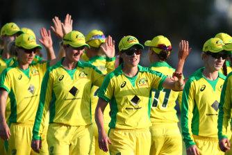 Australia celebrates after winning game one of the Women's ODI against Sri Lanka.