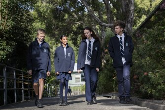 From left: Year 8 students Josh Bencsik and Zoe Rasinathan, year 11 students Scarlett Kimber and Manuel Villasmil, all wearing the Australian-first schoolwear jacket made from plastic bottles.