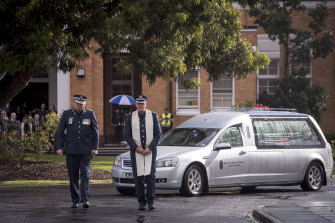 The sun broke through as Chief Commissioner Graham Ashton led the hearse out of the academy grounds.