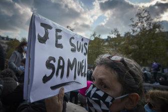 An anti-terrorism protestor at Paris' Place de La Republique following the brutal killing of teacher Samuel Paty.