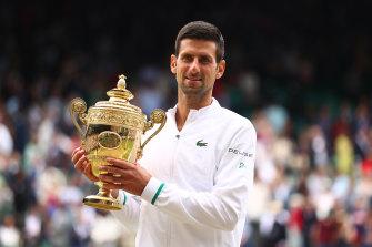 Novak Djokovic with the Wimbledon trophy.
