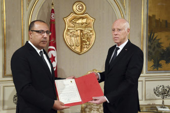 Tunisian President Kais Saied, right, appoints Interior Minister Hichem Mechichi as the new Prime Minister in July.
