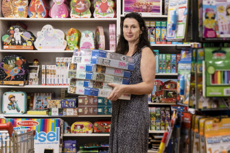 Clare Gordon who is a shop assistant at Discount Toy Company is being rushed off her feet with orders for puzzles and games.