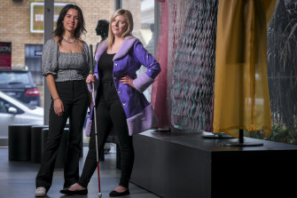 Kathryn McPherson (right) wearing the coat designed for her by Kangan Institute graduate Sabrina Sekerovski.