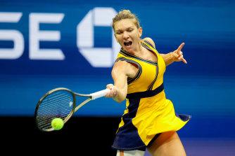 Simona Halep returns the ball to Kristina Kucova during their second round clash.