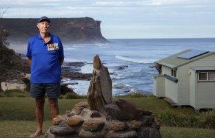 Vietnam War veteran Tim Strange stands next to the memorial at Little Garie Beach.