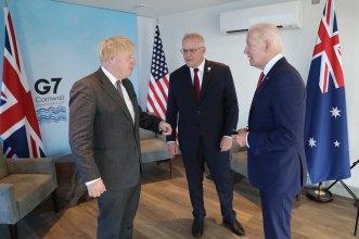 British Prime Minister Boris Johnson, Australia's Prime Minister Scott Morrison and US President Joe Biden meet at the G7 gathering in Cornwall on Saturday.