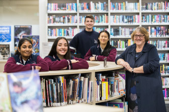 Keilor Downs College principal Linda Maxwell with some of her students, who thrived despite COVID disruptions.