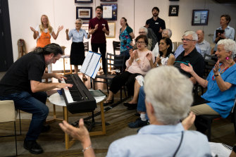 """The music floats up"": choirmaster Robert Teicher, on keyboards, leads the Chris O'Brien Lifehouse choir that includes former science teacher Michael Tapsell, second from right, and long-time Play School presenter Benita Collings, right."