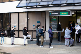 Queues outside a Sydney Centrelink office in July