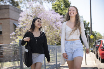 Year 12 students Andrhea Alabe and Clare Wilkes leave St Marys Senior High School for the last time after their final HSC exam on Wednesday.