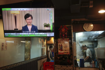 Hong Kong Chief Executive Carrie Lam makes an announcement on an extradition bill in television message, seen at a restaurant in Hong Kong, on Wednesday, September 4, 2019