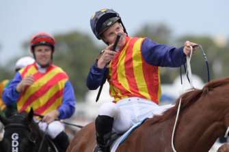 James McDonald celebrates Nature Strip's win in The Galaxy.