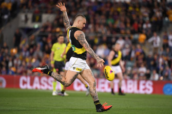 Dustin Martin of the Tigers kicks one of six goals in a dominating display.
