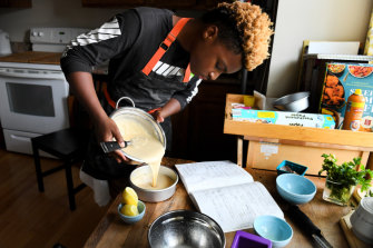 Michael Platt makes a lemon cake at his home in Bowie, Maryland. The 13-year-old started Michaels Desserts and gives away one cupcake to the homeless for every one he sells.