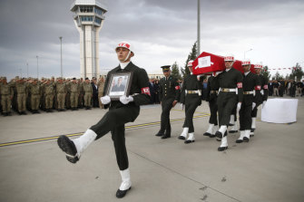 Turkish soldiers carry the Turkish flag-draped coffin of soldier Sefa Findik killed in action in Syria earlier in the day, in Sanliurfa, southeastern Turkey, on Sunday.