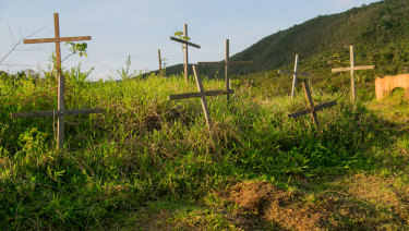 Crosses mark the lives lost at Bento Rodrigues.