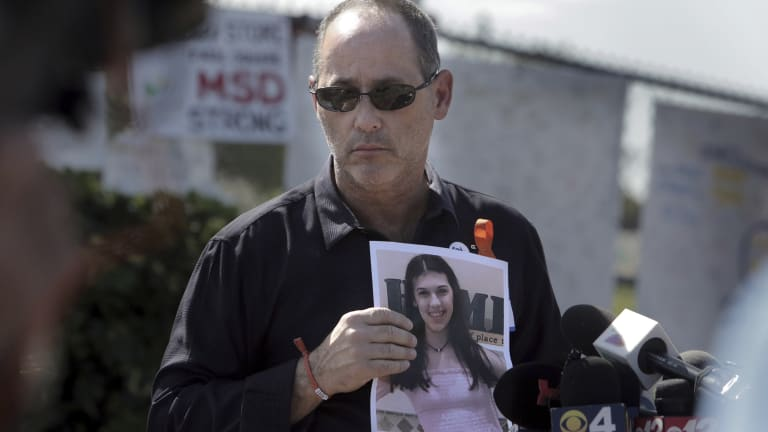 Fred Guttenberg, father of Jaime Guttenberg, with a picture of his daughter as parents of the victims of the Valentine's Day shooting read a prepared statement, calling on the state's Legislature to pass a bill they believe will improve school security.