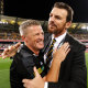 Richmond's senior coach Damien Hardwick (left) and CEO Brendon Gale celebrate the club's third AFL premiership in four years.