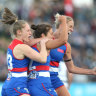 AFLW: Second-term blitz helps Dogs to win over Cats