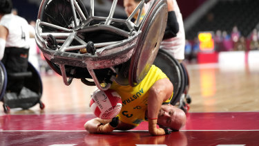 Australia's Ryley Batt falls during the wheelchair rugby bronze medal match against Japan.