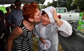 One Nation leader Senator Pauline Hanson (left) and ALP member for Bundamba, Jo-Ann Miller (right) are seen together in the suburb of Bundamba in Ipswich in 2017